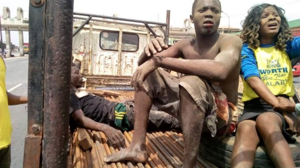 Photos: Many injured as truck loaded with crates of beer skids off Enugu/Onitsha Expressway
