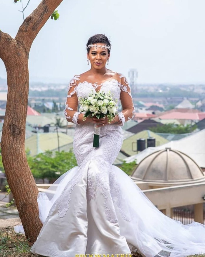 TBoss fuels pregnancy rumors after releasing wedding-themed photos