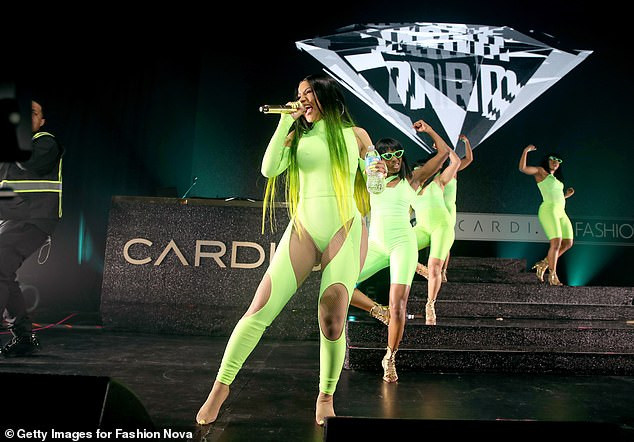Cardi B flaunts her curves in eye-catching thong bodysuit as she performs on stage (Photos)
