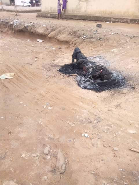 Graphic Photo: Armed robbery gang leader burnt to death in Abuja