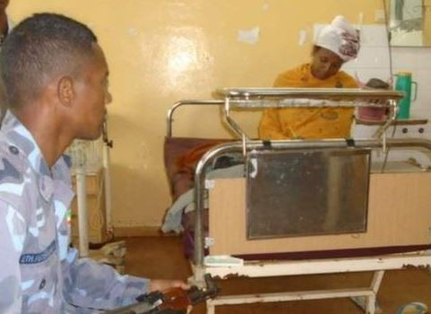Photo: 21-year old Ethiopian woman sits for an exam 30 minutes after giving birth to her son