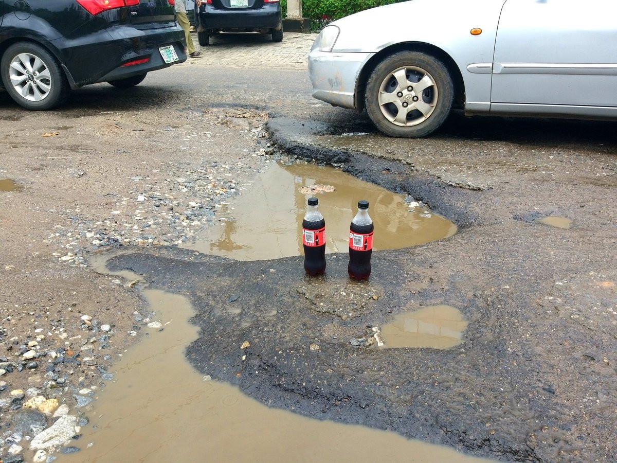 Nigerian lawyer celebrates potholes that keeps expanding, with soda