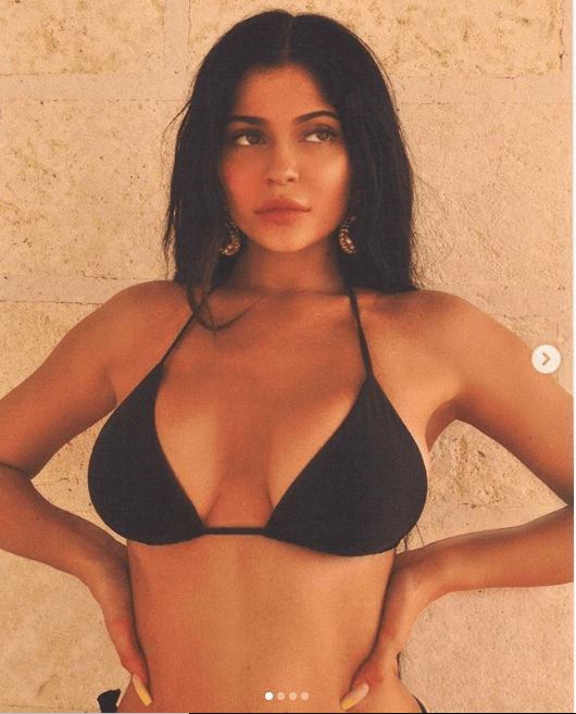 Kylie Jenner puts her curves on display in sexy bikini photos