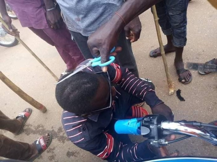 Taskforce forcefully shave young men