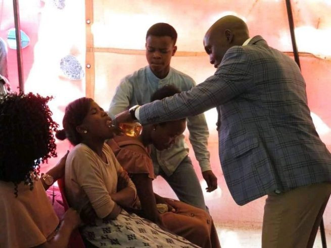 PHOTOS: Prophet shares alcohol as communion in church 3