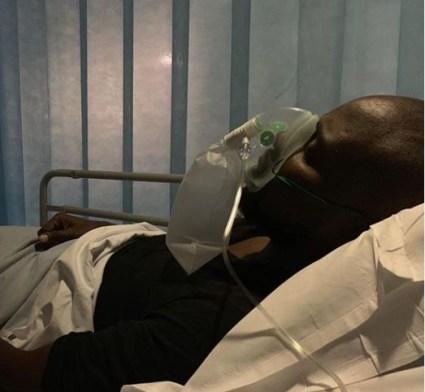 Dokun Olumofin in a hospital bed