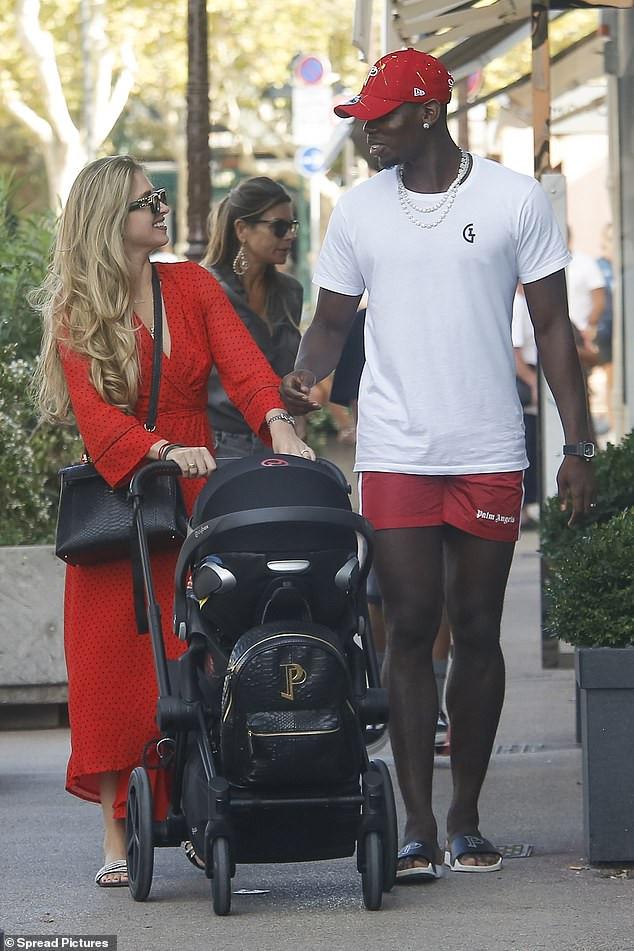 Man.U star Paul Pogba and girlfriend Maria Salaues take their son for a sunny stroll in Saint Tropez (Photos)