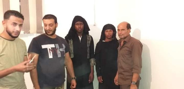 Photos: Two male African migrants wearing women?s hijab arrested in Libya
