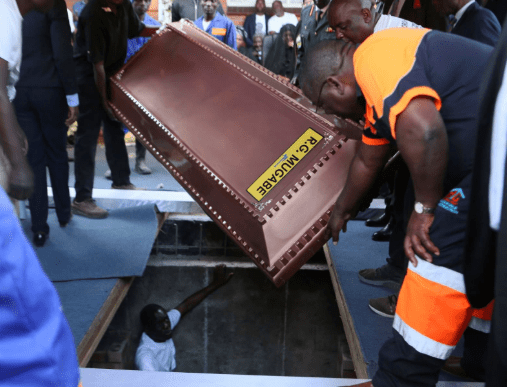Robert Mugabe buried in�steel coffin encased in concrete as family claims people are 'after his body'