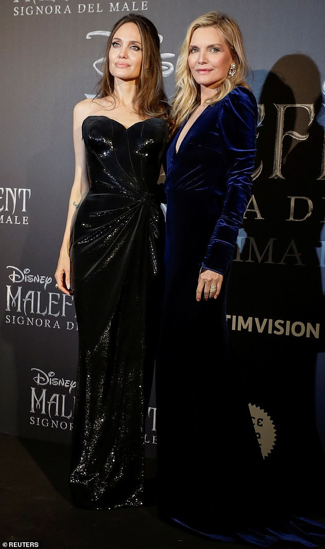 Angelina Jolie steps out with beautiful teen daughters at Maleficent