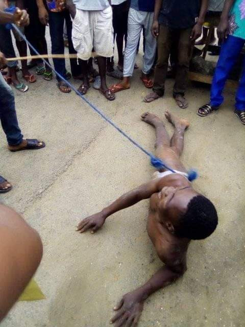 Young man stripped down to his underwear, given 50 strokes of cane and paraded for stealing solar light battery in Bayelsa community (photos)