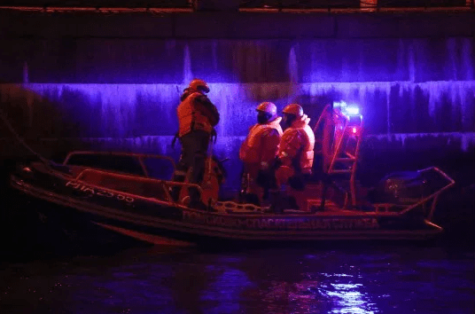 Professor arrested on suspicion of murder after he was dragged from a river with severed arms of his student in his bag