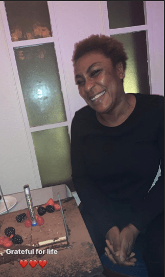 Burna boy and his team serenade his mother on her birthday (video)