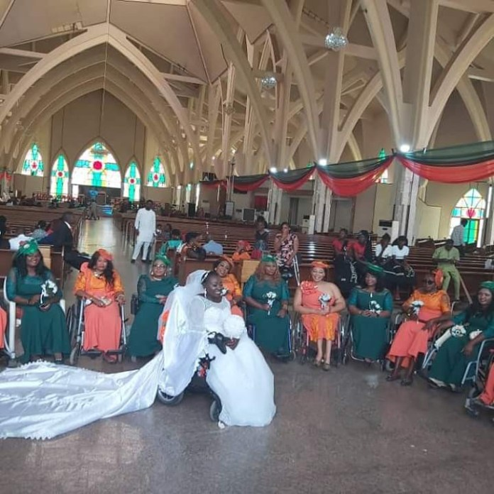Physically challenged Nigerian lady weds her husband in Abuja with a bridal train of ladies on wheelchairs (photos)
