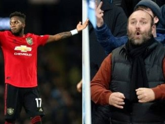 Man arrested by police for allegedly making 'monkey' gestures towards Man U. player Fred, denies being racist