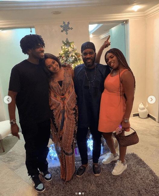 Nigerian football legend Jay-Jay Okocha poses with his wife and children for New Year