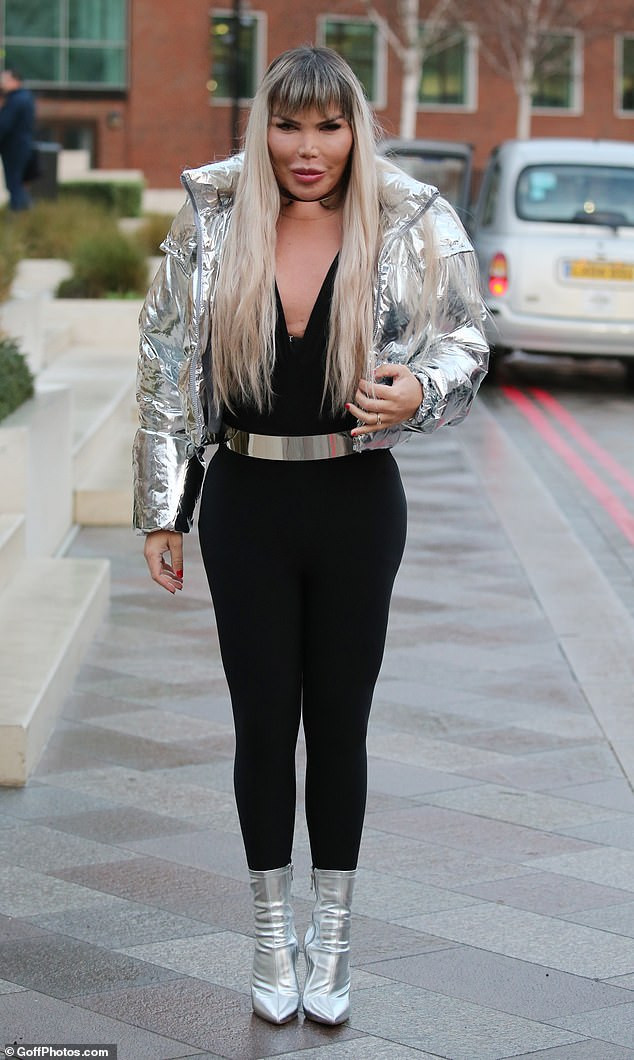 Human Ken Doll Rodrigo Alves flaunts her curves in black jumpsuit as she makes her first outing as a transgender woman (Photos)