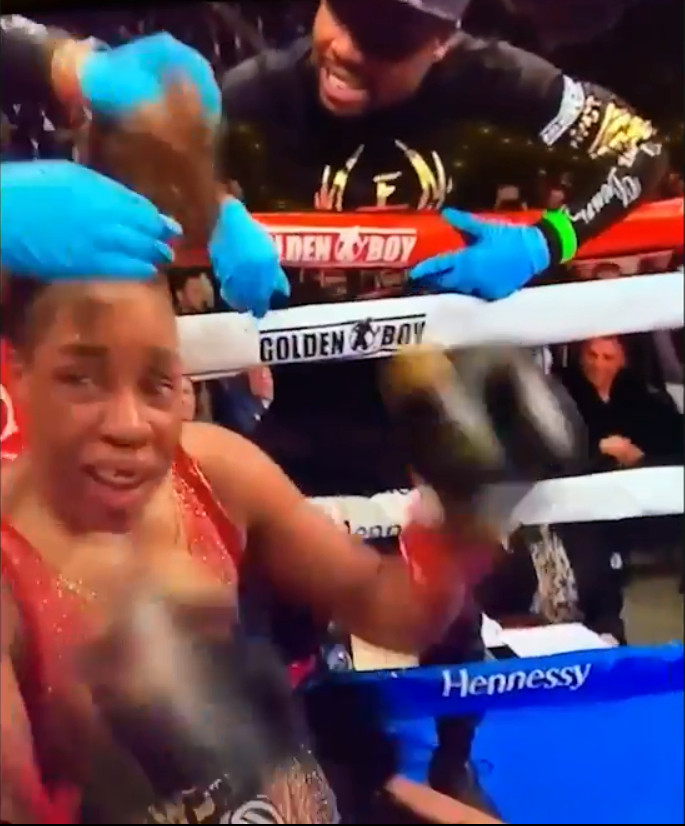Watch moment Coach slaps female boxer on the cheek and then removes her wig to motivate her from losing fight (video)