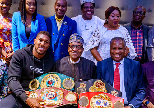 Anthony Joshua prostrates as he presents his World Heavy Championship belts to President Buhari in London (Photos)