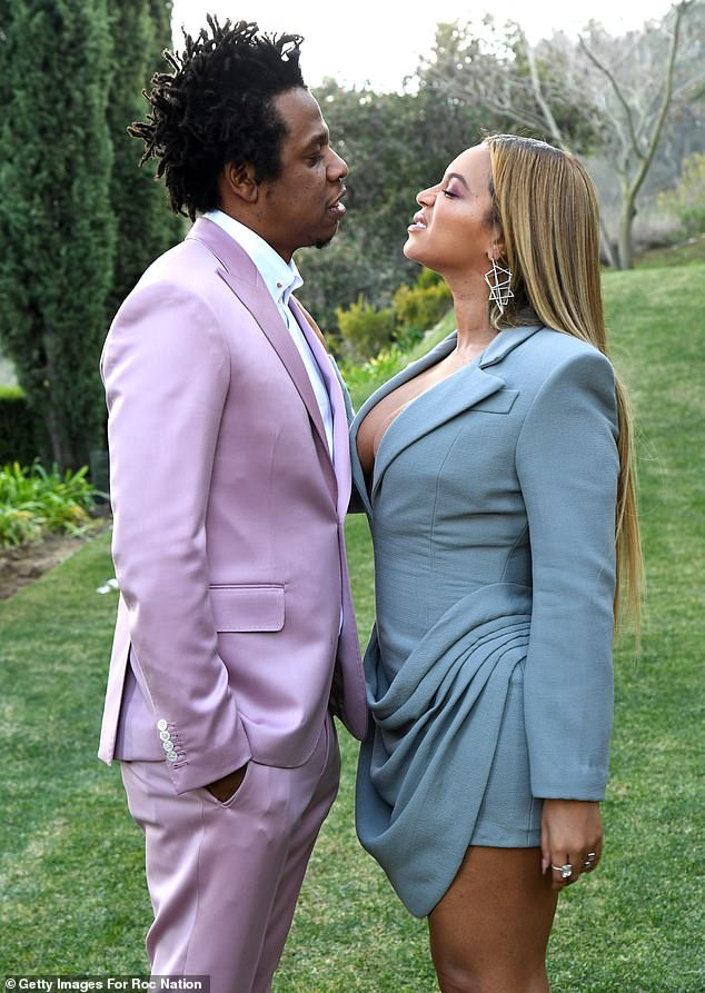 Beyonce and Jay-Z strike playful poses at the annual Roc Nation pre-Grammy brunch in Los Angeles (Photos)