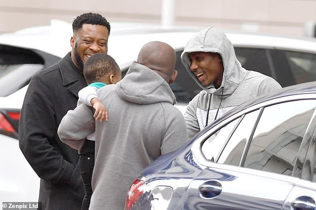 Odion Ighalo all smiles as he leaves Manchester hotel after securing Man United move (photos)
