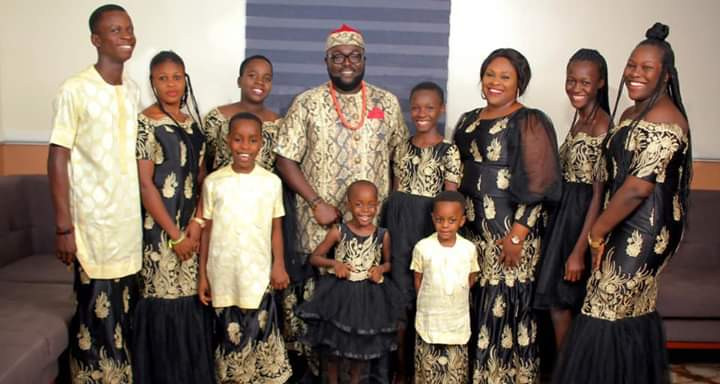 """Nigerian man shares lovely photo of his """"God-sent wife, 5 awesome biological children, 3 amazing adopted kids and one fantastic house maid"""" as he celebrates 16th wedding anniversary"""