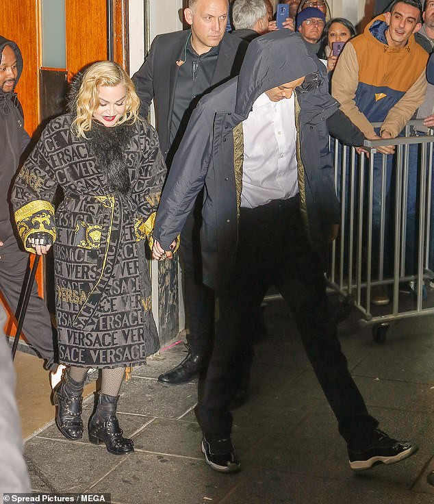 Madonna, 61, hold hands with her toyboy beau Ahlamalik Williams, 25, as they leave her show together (Photos)