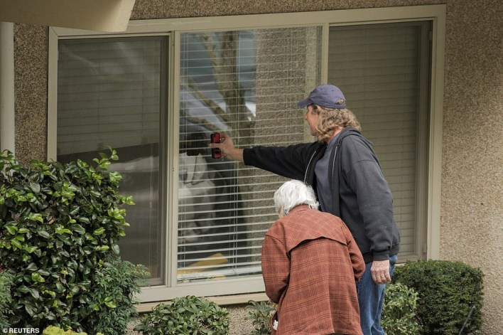Heartbreaking photos show wife speaking to her husband of 60-years through the window while he?s quarantined for coronavirus