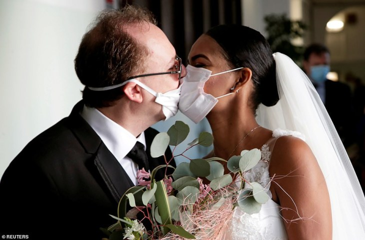 Coronavirus: Newlyweds kiss in Italy through protective masks at their wedding (Photos)