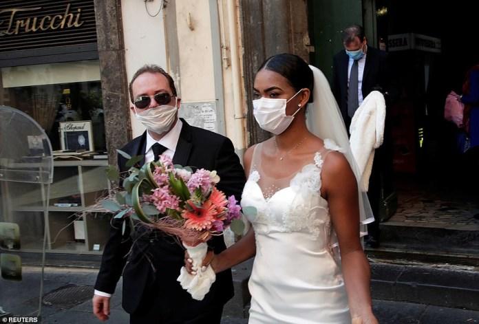 Coronavirus: Newlyweds kiss in Italy through protective masks at their wedding (Photos)