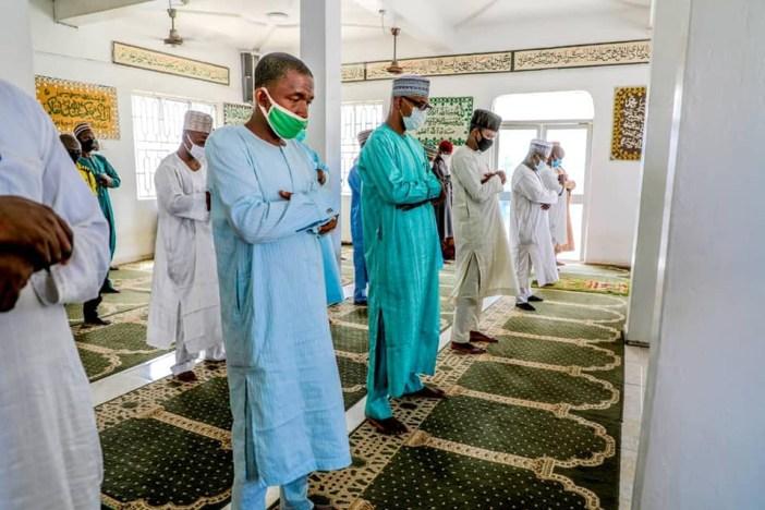 Kano state governor, Umar Ganduje and his aides observe
