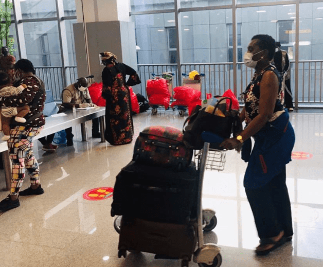 324 Nigerians evacuated from the US arrive Abuja (photos)