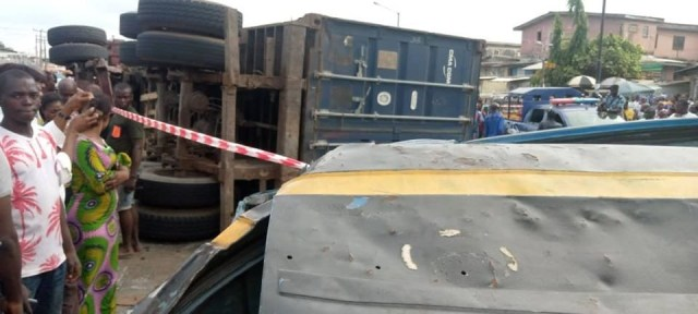Two die as container falls on bus in Lagos (photos)