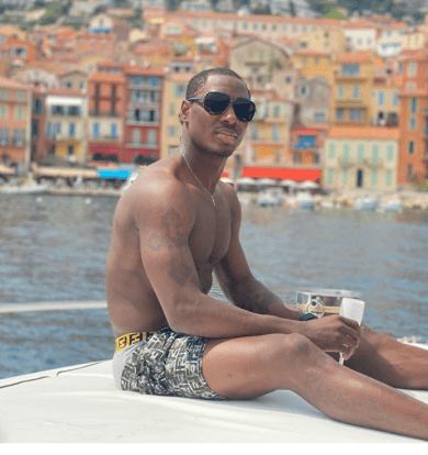 Odion Ighalo shares shirtless photos as he kicks off his holiday with boat cruise