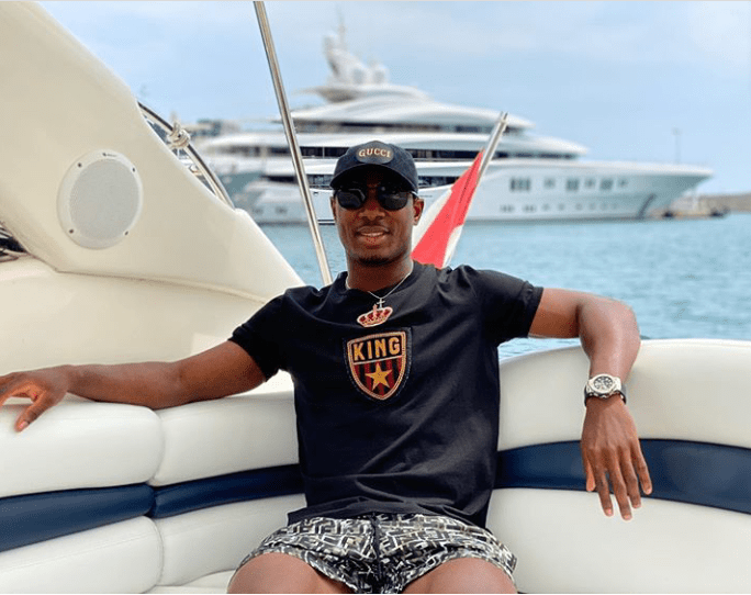 Odion Ighalo goes shirtless as he kicks off his holiday with boat cruise (photos)