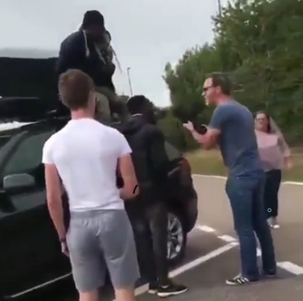 Family arrives back in the UK from holiday in Europe and discovers two Africans hiding in their car roof rack (video)
