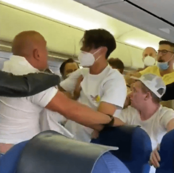 Fight breaks out onboard flight to Ibiza after two Brit passengers refused to wear masks (video)