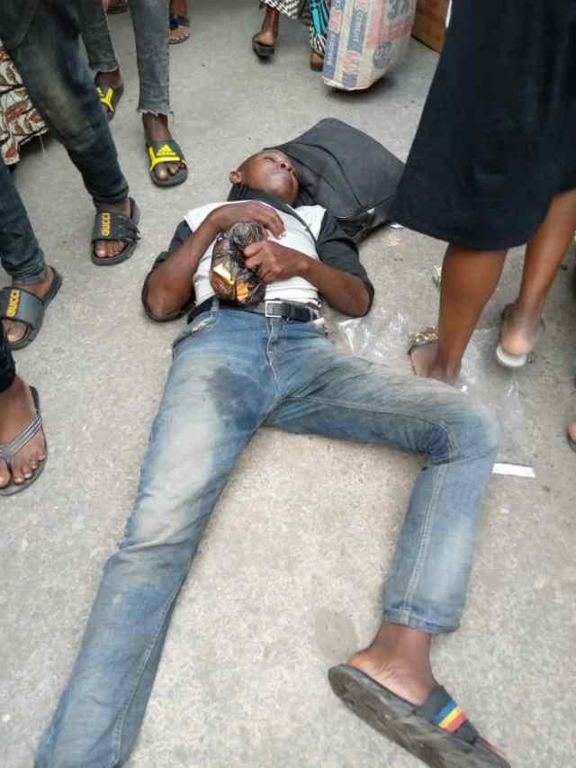 Man falls asleep near bridge in Lagos