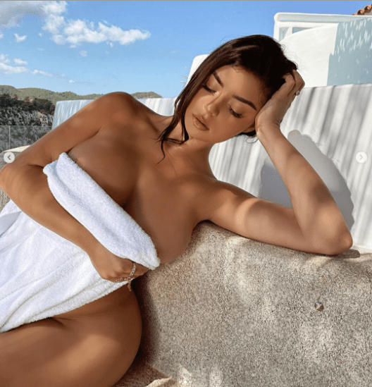 Demi Rose strips completely to expose killer curves while partying in Ibiza