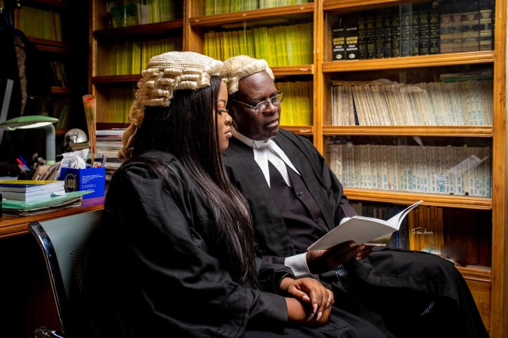 Woman and her lawyer father go viral as she recreates a childhood photo with him, after being called to the bar