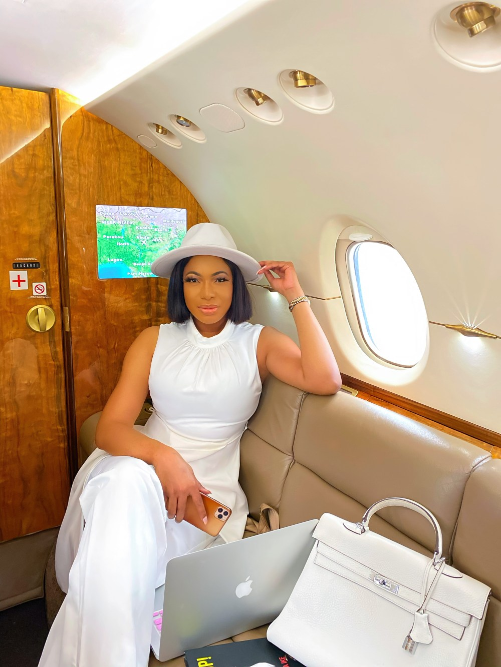 Chika Ike giving us boss vibes in a private jet