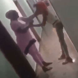 Nigerian mother teaches her whore daughter lesson after catching her in a hotel room with a man (video)