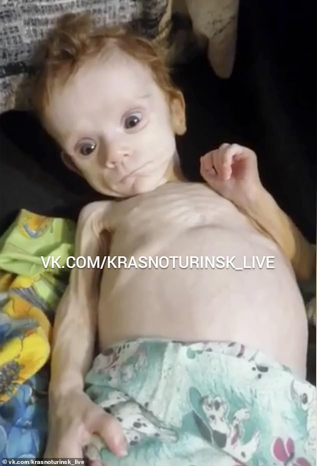 Emaciated baby girl is rescued in Russia after being left to starve to death in a cupboard by her mother (photos)