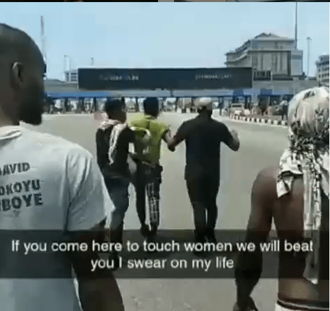 End SARS protesters beat up a young man accused of inappropriately touching a woman at the Lekki protest (video)