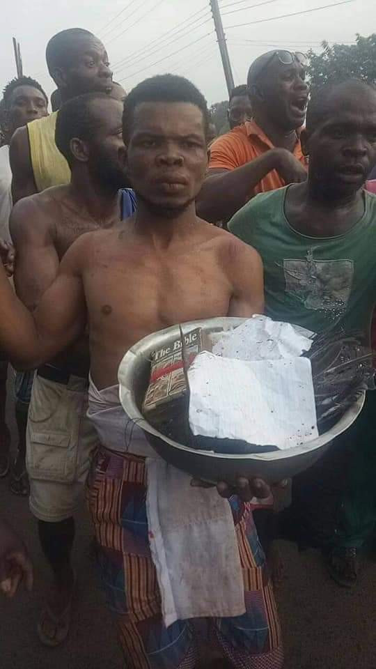 Anambra pastor stripped and paraded in village after he was allegedly caught with charms (photos/video)