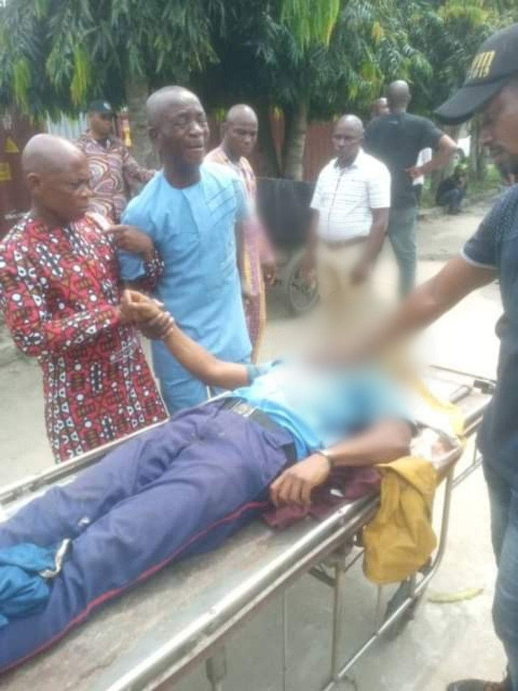 Heartbreaking photos of a father weeping inconsolably after seeing the body of his son allegedly shot dead by police officer in Rivers State