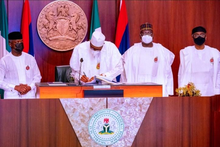 President Buhari signs 2021 budget into law (photos)