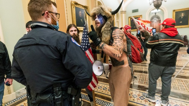 US Capitol riot: Shirtless man in face paint and horn arrested