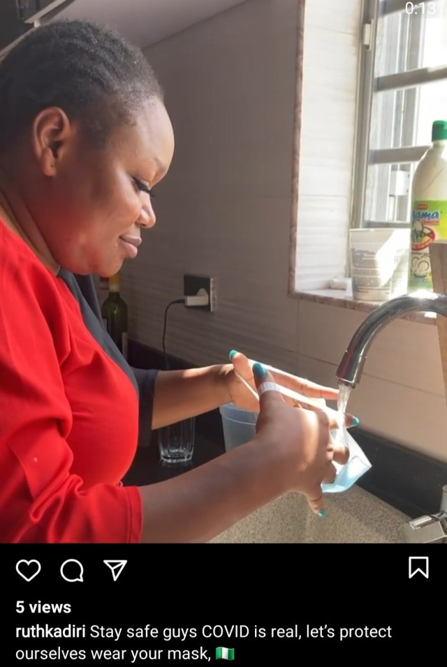 Ruth Kadiri experiments with face mask to show that it works to prevent against droplets carrying the coronavirus