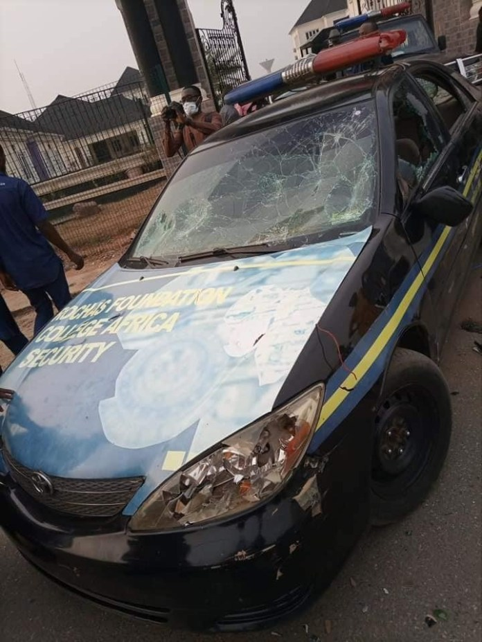 Many injured and cars destroyed as Okorocha and Uzodinma supporters clash in Imo (photos)